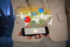 Составное изображение midsection коммерсантки держа умный телефон Стоковое Фото