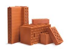 Состав блоков красных кирпичей керамических на белой предпосылке стоковое изображение