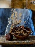 Состав бутылки, гранатового дерева, корзины и вянуть цветков Стоковые Фотографии RF