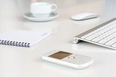 Состав дела на белом столе с кофе Стоковые Изображения