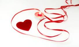 Состав и свечи сердца на день ` s валентинки Стоковые Фото