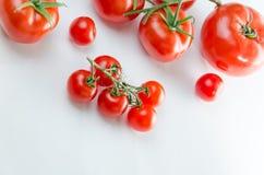 Состав малой вишни и большого томата стоковое изображение