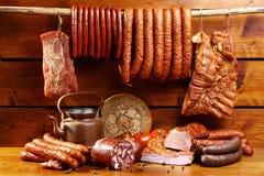 Состав мяса на деревянной предпосылке Стоковая Фотография