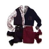 Состав одежд на белой предпосылке Стоковая Фотография