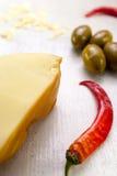 Состав пищи перца chili, зеленых оливок и сыра Стоковое фото RF