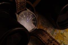 Состав пилотных wristwatch, карты и биноклей Стоковые Изображения