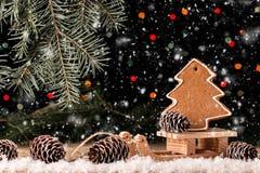 Состав рождества с пряником и розвальнями Стоковые Фото