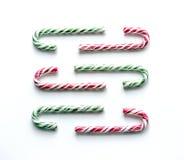 Состав рождества с сладостным льдом на белой предпосылке Стоковые Фото
