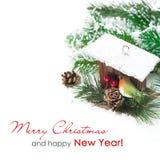 Состав рождества при изолированные ветви и birdhouse ели, Стоковое фото RF