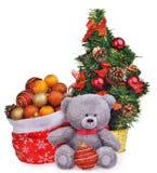 Состав рождества с деревом плюшевого медвежонка и santa кладут в мешки Стоковое Фото