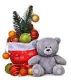 Состав рождества с сумкой Санта Клауса вполне игрушек и усмехаясь плюшевого медвежонка Стоковая Фотография