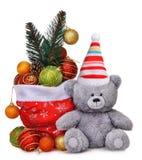 Состав рождества с сумкой Санта Клауса вполне игрушек и усмехаясь плюшевого медвежонка Стоковое Изображение