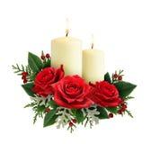 Состав рождества с цветками и свечами красной розы Стоковые Фотографии RF