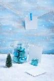 Состав рождества: украшения, дерево, подарок и фото Стоковые Изображения