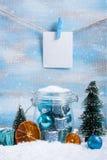 Состав рождества: украшения, дерево, подарок и фото Стоковое Изображение