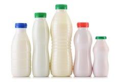 Состав с пластичными бутылками молочных продуктов Стоковое Фото
