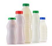 Состав с пластичными бутылками молочных продуктов Стоковые Фото