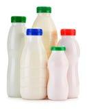 Состав с пластичными бутылками продуктов молока Стоковые Фото
