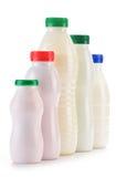 Состав с пластичными бутылками продуктов молока Стоковое Фото