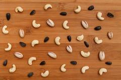 Состав чокнутой картины - смешайте анакардии, семена подсолнуха, фисташки Стоковое Изображение