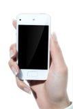 Сотовый телефон в руке Стоковое Изображение