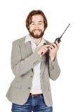 Сотрудник охраны связывая через его звуковое кино walkie Стоковое Фото