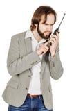 Сотрудник охраны связывая через его звуковое кино walkie Стоковая Фотография