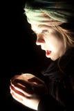 Сотрясенная сторона хрустального шара женщины Стоковые Фотографии RF