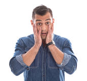 Сотрясенный: молодой человек в голубой рубашке джинсовой ткани при руки касаясь стороне Стоковые Изображения RF
