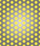 Сот металла на желтой предпосылке Стоковые Изображения RF