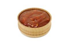 Соус Chili горячий в деревянном блюде Стоковое фото RF