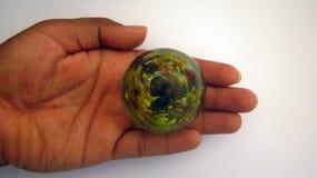 Сохраньте сообщение земли через стеклянный шарик Стоковое Изображение