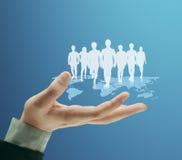 Социальная структура сети в руке Стоковые Изображения