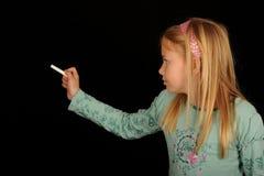 сочинительство девушки классн классного Стоковое фото RF