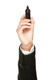 сочинительство пер отметки удерживания черной руки Стоковые Изображения