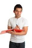 сочинительство студента тетради человека Стоковая Фотография RF
