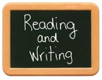 сочинительство чтения s ребенка chalkboard миниое Стоковая Фотография RF