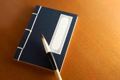сочинительство щетки книги китайское Стоковая Фотография RF
