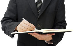 Сочинительство бизнесмена в дневнике дела Стоковые Изображения RF