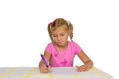 Сочинительство ребенка на пустой бумаге Стоковая Фотография