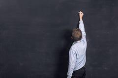 Сочинительство ребенка на черной доске Стоковое фото RF