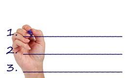 Сочинительство руки на незаполненной с космосом экземпляра Стоковое Изображение RF