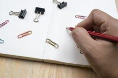 Сочинительство руки на тетради Стоковое Изображение RF