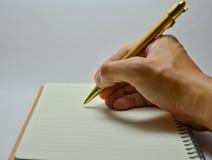Сочинительство руки на тетради Стоковые Фото