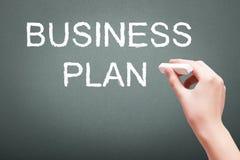 Сочинительство руки с концепцией бизнес-плана мела Стоковые Фото
