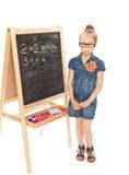 сочинительство таблицы школьницы умножения урока сердца классн классного Стоковые Изображения