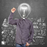 Сочинительство человека лампы головное что-то Стоковое фото RF