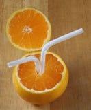 Сочные апельсины с трубками для коктеиля Стоковое Фото