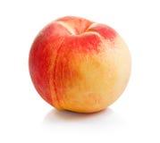 Сочный зрелый персик на белой предпосылке Стоковое Изображение