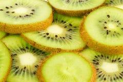 Сочный плодоовощ кивиа отрезает предпосылку Стоковые Фотографии RF